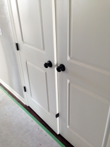 all the door knobs and hinges are in! we went with oil rubbed bronze finish for these and i LOVE it.