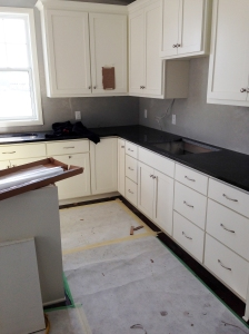 counter tops are in! this was the one part of our house i was the most anxious about. and i really like them! it's called 'india copper brown' and it's great..dark but doesn't streak easily or show water stain. win. win.