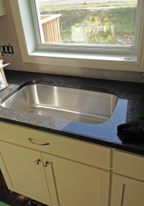 our kitchen sink! we opted for the single sink for more room to wash dishes.