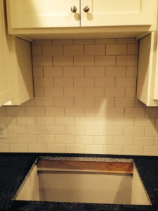 we decided on a white, matte subway tile with sightly darker grout for the backsplash. i LOVE it.