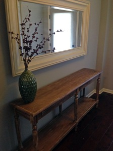 the only 'room' in our house that is even almost done is our entry way :) but i snagged this table from world market last night and it was really reasonably priced! plus free mirror from family friends and vase from the condo equals my bargain hunting itch getting sufficiently scratched in this nook.