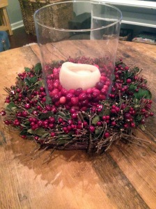 i took a little wreath and filled the center with a hurricane, candle and of course more cranberries! i think it's kinda cute..