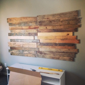the finished pallet wall! we wanted ours as a frame for the tv so from here pauly drilled holes in the wall and pallet wall to hide the cords for the tv.