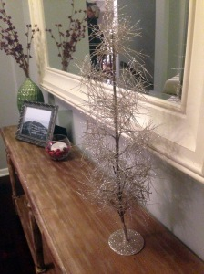 my mom picked up this adorable sparkly tree for me at west elm while she was here. sparkles are to christmas as air to life--necessary.